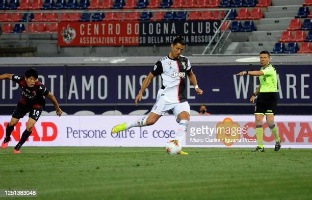 Cristiano Ronaldo of Juventus scores the opening goal from the penalty spot during the Serie A match between Bologna FC and Juventus at Stadio Renato...