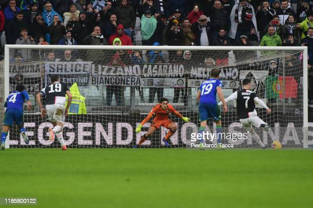 Cristiano Ronaldo of Juventus scores the penalty during the Serie A match between Juventus and US Sassuolo at on December 1 2019 in Turin Italy