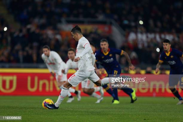 Cristiano Ronaldo of Juventus scores the team's second goal from penalty spot during the Serie A match between AS Roma and Juventus at Stadio...