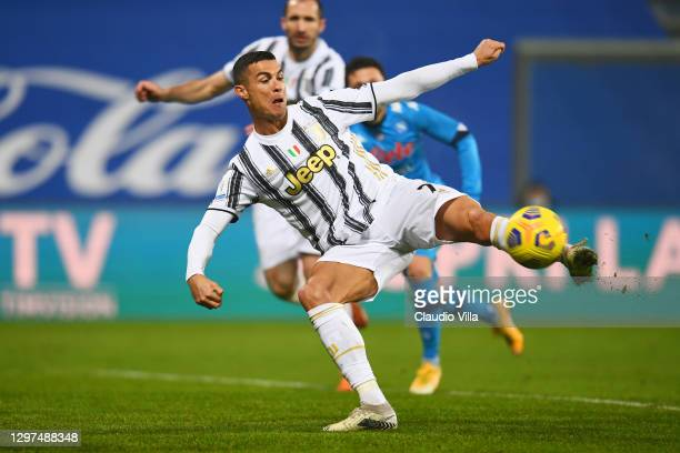 Cristiano Ronaldo of Juventus scores their sides first goal during the Italian PS5 Supercup match between Juventus and SSC Napoli at Mapei Stadium -...