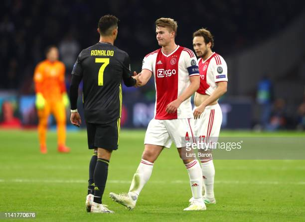 Cristiano Ronaldo of Juventus shakes hands with Matthijs de Ligt of Ajax after the UEFA Champions League Quarter Final first leg match between Ajax...