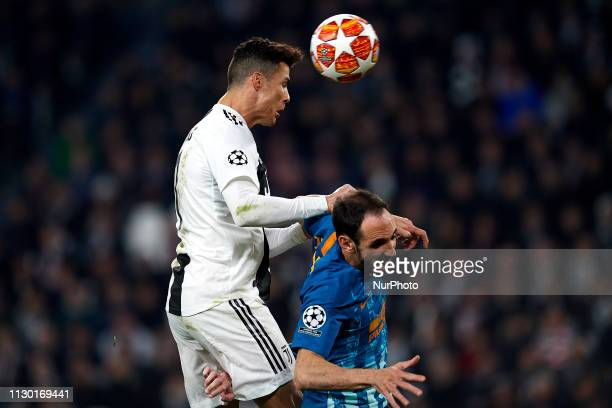 Cristiano Ronaldo of Juventus shooting to goal front Juanfran of Atletico Madrid during the UEFA Champions League Round of 16 Second Leg match...