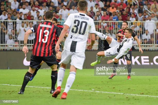 Cristiano Ronaldo of Juventus shoots the ball on overturned during the Italian Supercup match between Juventus and AC Milan at King Abdullah Sports...