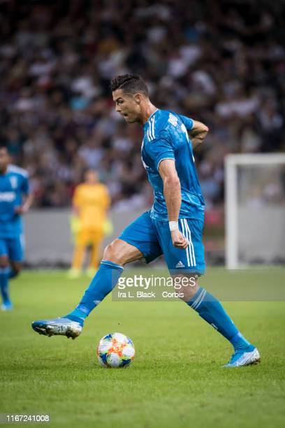 Cristiano Ronaldo of Juventus shows off his footwork with the ball during the international Champions Cup Friendly match between Atletico de Madrid...