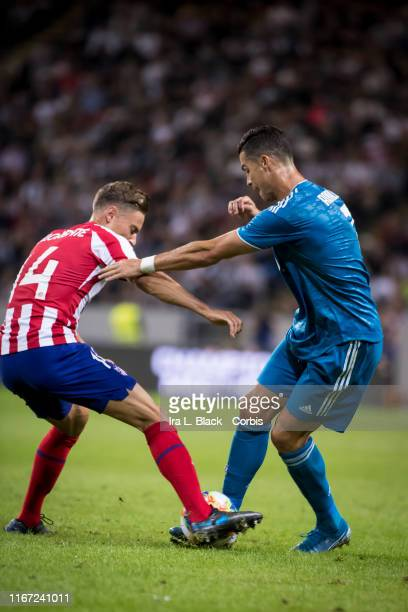 Cristiano Ronaldo of Juventus shows off his footwork with the ball against Llorente of Atletico Madrid during the international Champions Cup...