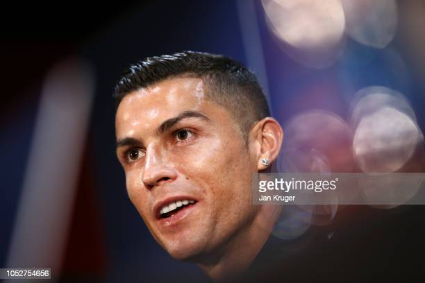 Cristiano Ronaldo of Juventus speaks to media during a press conference ahead of their UEFA Champions League Group H match against Manchester United...