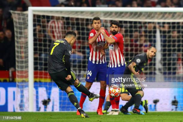 Cristiano Ronaldo of Juventus takes a freekick during the UEFA Champions League Round of 16 First Leg match between Club Atletico de Madrid and...