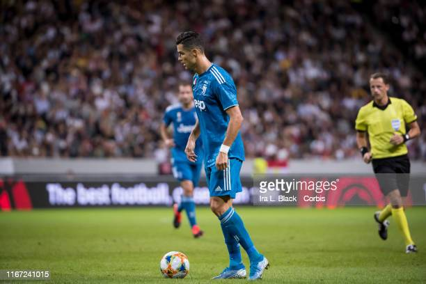 Cristiano Ronaldo of Juventus takes a moment with the ball during the international Champions Cup Friendly match between Atletico de Madrid and...