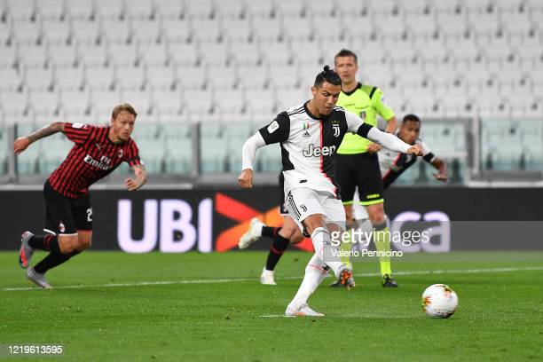 Cristiano Ronaldo of Juventus takes a penalty kick and misses during the Coppa Italia SemiFinal Second Leg match between Juventus and AC Milan at...