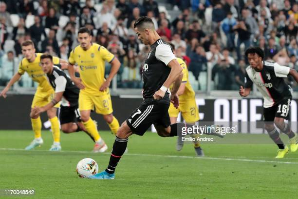 Cristiano Ronaldo of Juventus takes a penalty kick and scores the second goal of his team during the Serie A match between Juventus and Hellas Verona...