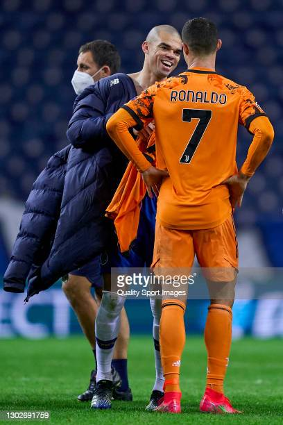 Cristiano Ronaldo of Juventus talks with Kepler Lima 'Pepe' of FC Porto at the end of the UEFA Champions League Round of 16 match between FC Porto...