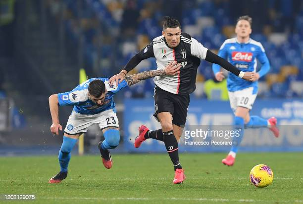 Cristiano Ronaldo of Juventus vies with Elseid Hysaj of SSC Napoli during the Serie A match between SSC Napoli and Juventus at Stadio San Paolo on...