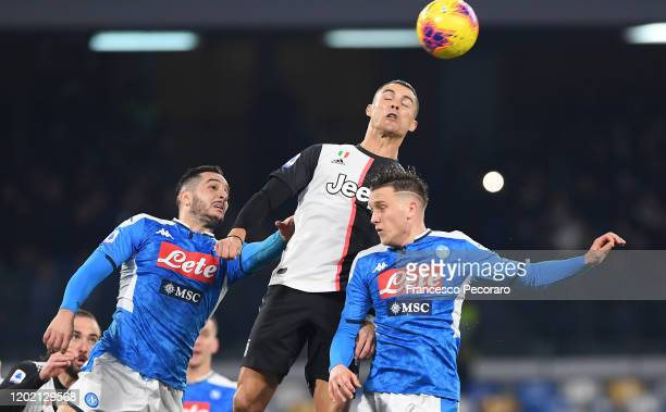 Cristiano Ronaldo of Juventus vies with Kostantinos Manolas and Piotr Zielinski of SSC Napoli during the Serie A match between SSC Napoli and...