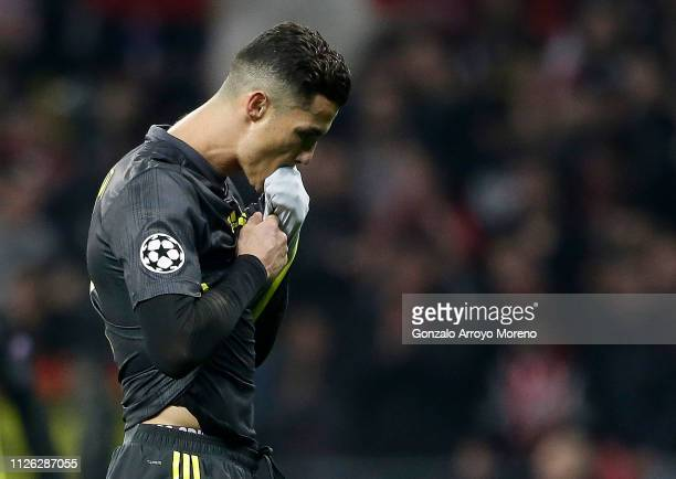 Cristiano Ronaldo of Juventus walks off the pitch dejected after defeat in the UEFA Champions League Round of 16 First Leg match between Club...
