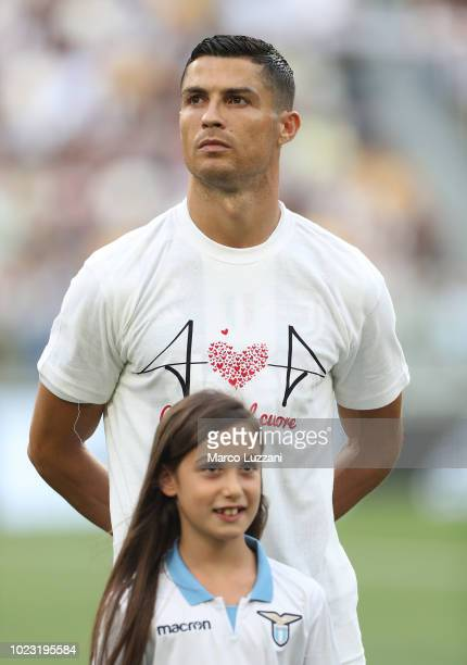Cristiano Ronaldo of Juventus wears a tshirt for the victims of Genoa's Morandi Bridge collapse prior to the Serie A match between Juventus and SS...