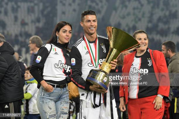 Cristiano Ronaldo of Juventus with his mother Maria Dolores Aveiro and girlfriend Georgina Rodriguez celebrates with the trophy after winning the...