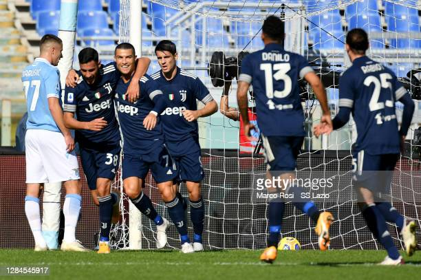 Cristiano Ronaldo of Juvetus celebrate a opening gao with his team mates during the Serie A match between SS Lazio and Juventus at Stadio Olimpico on...