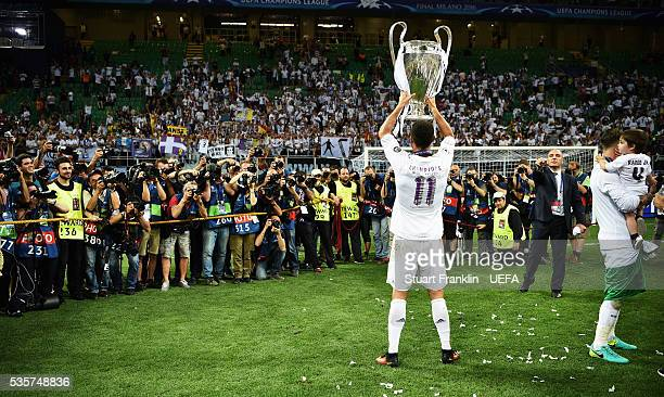 Cristiano Ronaldo of Madrid holds the winners trophy after the UEFA Champions League Final match between Real Madrid and Club Atletico de Madrid at...