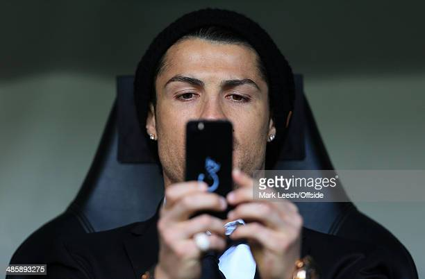 Cristiano Ronaldo of Madrid takes a picture on his mobile phone prior to the UEFA Champions League Quarter Final second leg match between Borussia...