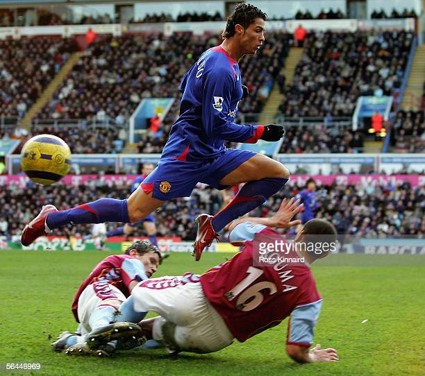 Cristiano Ronaldo of Manchester is challenged by Wilfred Bouma of Aston Villa during the Barclays Premiership match between Aston Villa and...