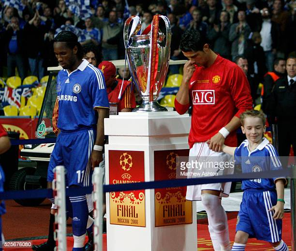 Cristiano Ronaldo of Manchester United and Didier Drogba of Chelsea walk past the Champions League Trophy