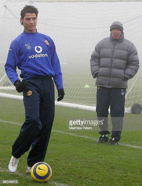 Cristiano Ronaldo of Manchester United and Manager Sir Alex Ferguson in action during a first team training session ahead of the UEFA Champions...
