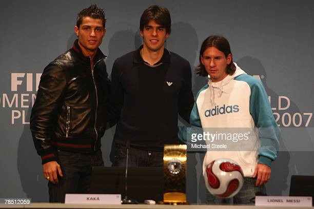 Cristiano Ronaldo of Manchester United and Portugal stands alongside Kaka of AC Milan and Brazil and Lionel Messi of Barcelona and Argentina during...