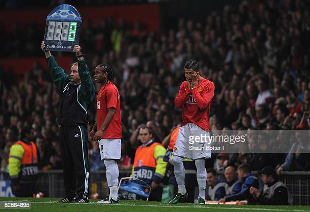 Cristiano Ronaldo of Manchester United and team mate Anderson prepare to come on as substitutes during the UEFA Champions League Group E match...
