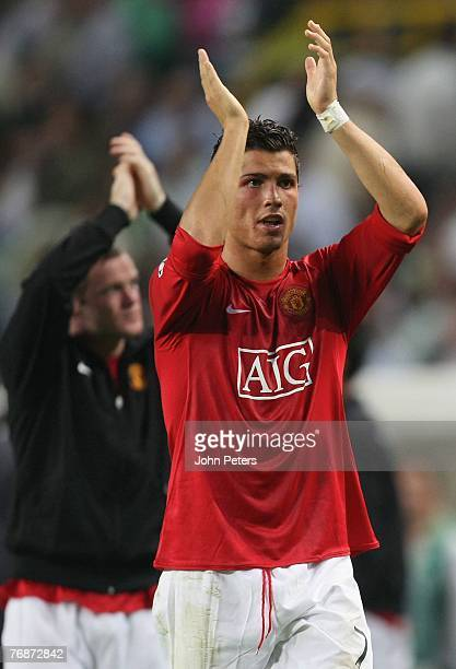 Cristiano Ronaldo of Manchester United applauds the fans the UEFA Champions League match between Sporting Lisbon and Manchester United at Jose...