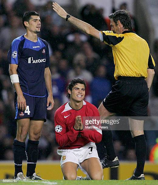 Cristiano Ronaldo of Manchester United applauds the Referee Stefano Farina's decision during the UEFA Champions League match between Manchester...