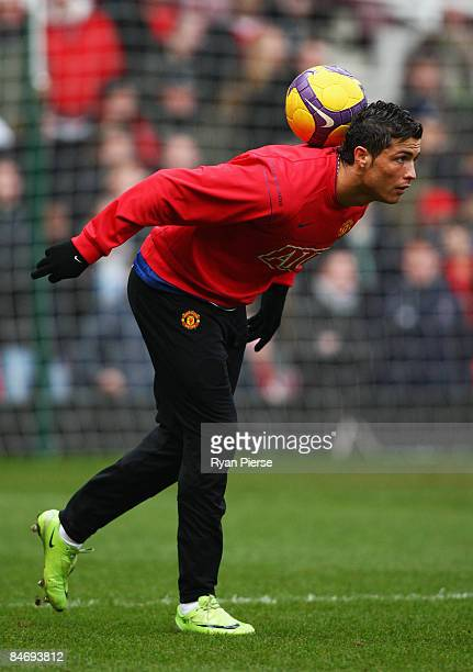 Cristiano Ronaldo of Manchester United balances the ball on the back of his neck in the warm up ahead of the Barclays Premier League match between...