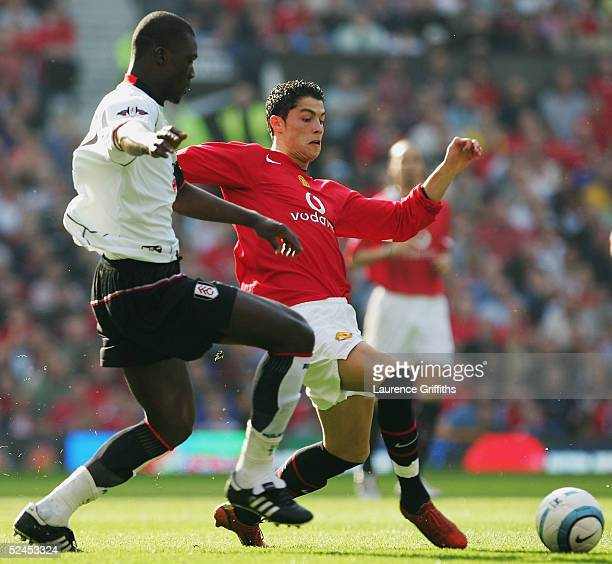 Cristiano Ronaldo of Manchester United battles for the ball with Papa Bouba Diop of Fulham during the FA Barclays Premiership match between...