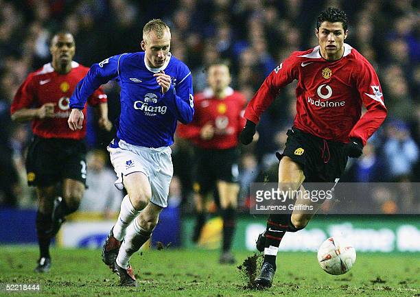 Cristiano Ronaldo of Manchester United battles for the ball with Tony Hibbert of Everton during the FA Cup Fifth Round match between Everton and...