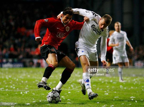 Cristiano Ronaldo of Manchester United battles with Michael Gravgaard of FC Copenhagen during the UEFA Champions League Group F match between FC...