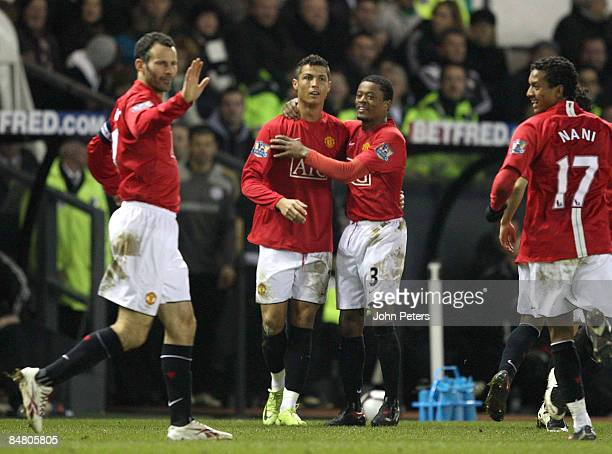 Cristiano Ronaldo of Manchester United celebrates after scoring their third goal with Patrice Evra during the FA Cup sponsored by eon Fifth Round...