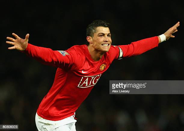 Cristiano Ronaldo of Manchester United celebrates as he scores their second goal during the Barclays Premier League match between Manchester United...