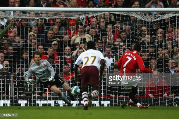 Cristiano Ronaldo of Manchester United celebrates his teams opening goal from the penalty spot during the Barclays Premier League match between...