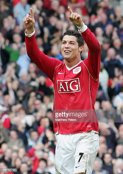 Cristiano Ronaldo of Manchester United celebrates JiSung Park scoring their third goal during the Barclays Premiership match between Manchester...