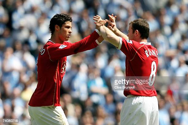Cristiano Ronaldo of Manchester United celebrates scoring a penalty with team mate Wayne Rooney during the Barclays Premiership match between...