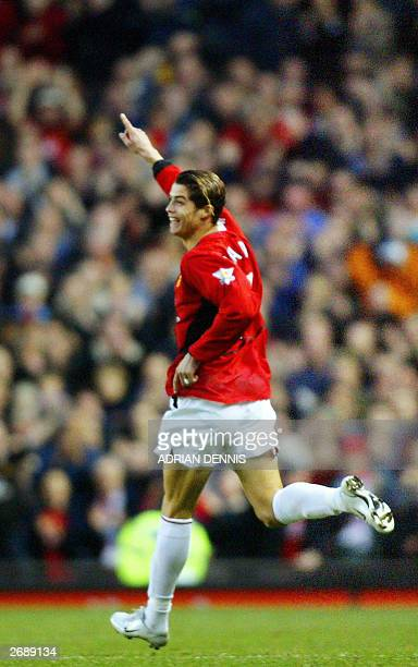 Cristiano Ronaldo of Manchester United celebrates scoring against Portsmouth during the Premiership match at Old Trafford in Manchester 01 November...