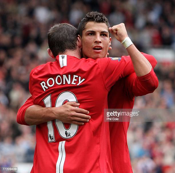 Cristiano Ronaldo of Manchester United celebrates scoring his second goal with Wayne Rooney during the Barclays Premier League match between...