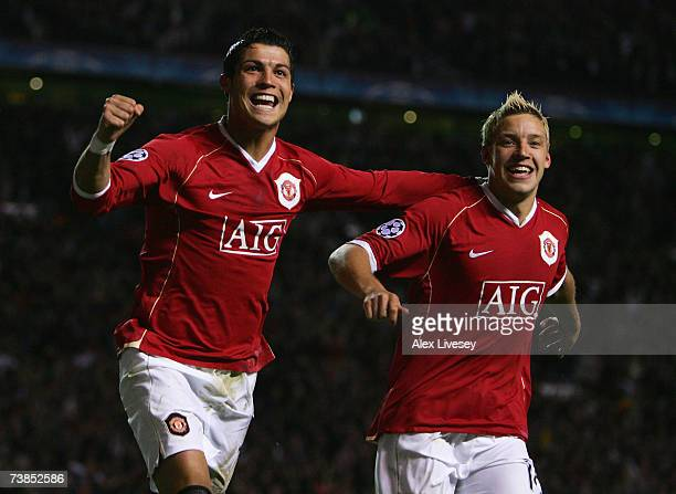 Cristiano Ronaldo of Manchester United celebrates scoring his team's fifth goal with team mate Alan Smith during the UEFA Champions League Quarter...