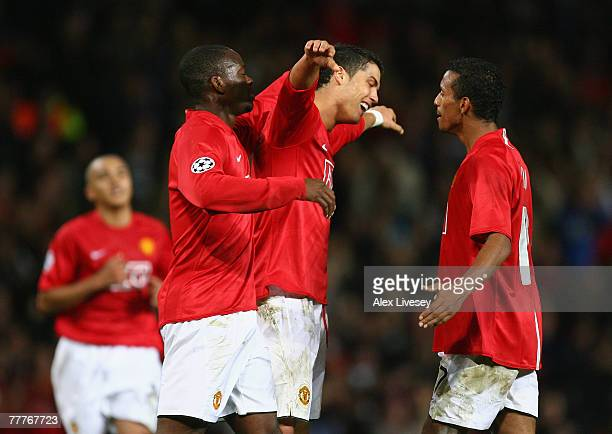 Cristiano Ronaldo of Manchester United celebrates scoring his team's fourth goal with team mates Louis Saha and Nani during the UEFA Champions League...
