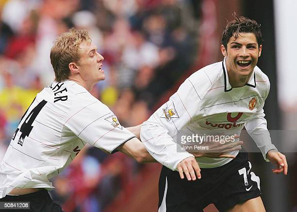 Cristiano Ronaldo of Manchester United celebrates scoring the first goal of the game with Darren Fletcher both players were later sent off by referee...