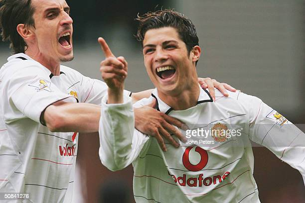 Cristiano Ronaldo of Manchester United celebrates scoring the first goal of the game with Gary Neville during the FA Barclaycard Premiership match...