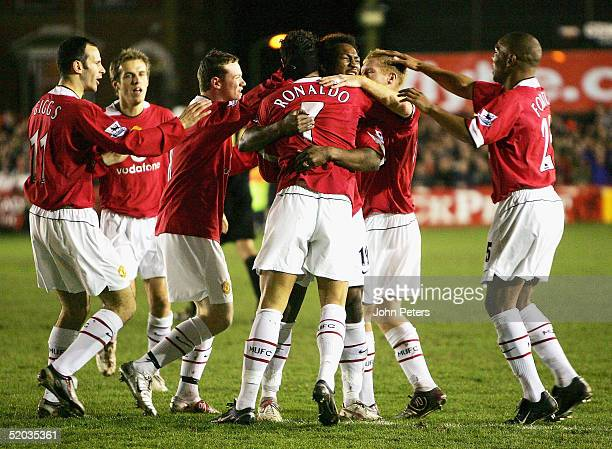 Cristiano Ronaldo of Manchester United celebrates scoring the first goal during the FA Cup third round replay match between Exeter City and...
