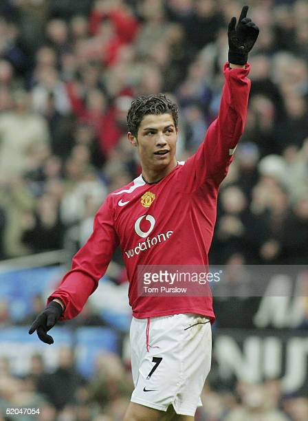 Cristiano Ronaldo of Manchester United celebrates scoring the first goal during the Barclays Premiership match between Manchester United and Aston...