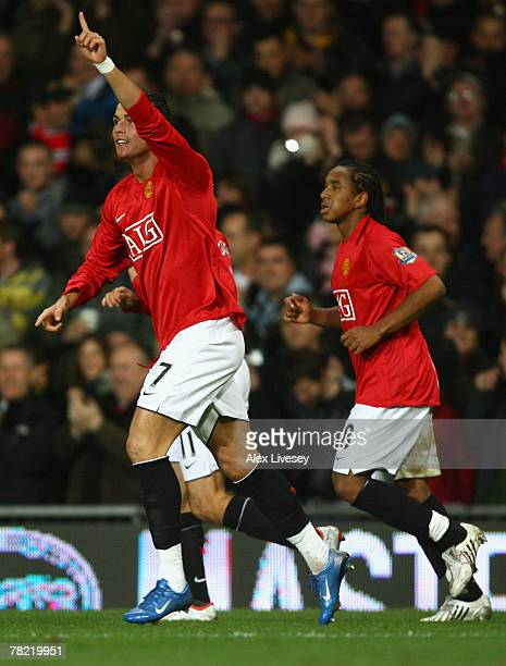 Cristiano Ronaldo of Manchester United celebrates scoring the opening goal during the Barclays Premier League match between Manchester United and...