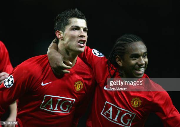 Cristiano Ronaldo of Manchester United celebrates scoring the opening goal with team mate Anderson during the UEFA Champions League first knockout...