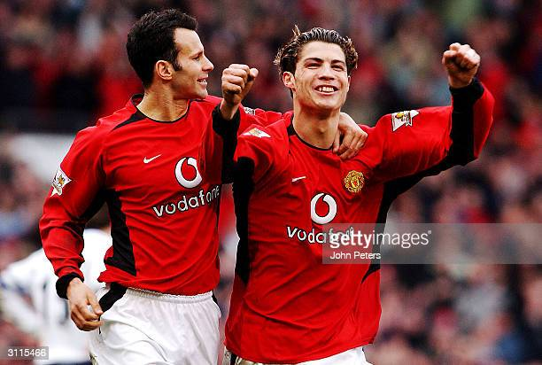 Cristiano Ronaldo of Manchester United celebrates scoring the second goal with teammate Ryan Giggs during the FA Barclaycard Premiership match...